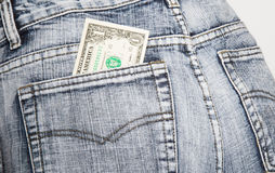 Money, the note of one dollar, in a hip-pocket of blue jeans Royalty Free Stock Images