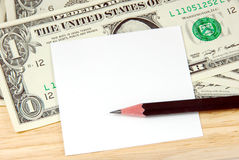 Money and note pad. Stock Photo