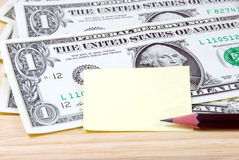 Money and note pad. Stock Images