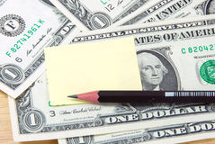 Money note pad and pencil. Stock Photography