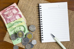 Money and note with pen. Stock Images