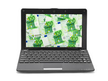 Money on notebook screen Royalty Free Stock Photos