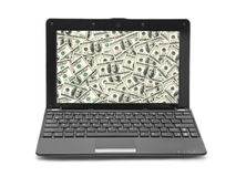 Money on notebook screen Stock Photo