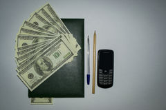 Money, Notepad , phone Royalty Free Stock Photo