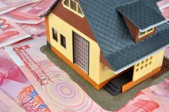 Money notes and house model Stock Images
