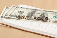 Money and notes to the word new work Royalty Free Stock Image