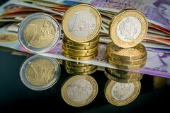 Free Money Of United Kingdom Close Up On Black Background. Pounds UK 10 And 20 Note And Euro Money Coins Royalty Free Stock Image - 176021026