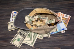 Money in the old cap Royalty Free Stock Photos