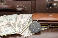 Money on an old suitcase Stock Photo