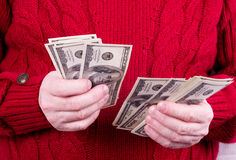 Money in old working man hands Royalty Free Stock Images