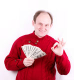 Money in old working man hands Stock Photos