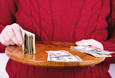 Money in old working man hands Royalty Free Stock Image