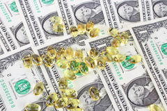 Money and omega 3. Omega 3 and money - one dollars background stock photography