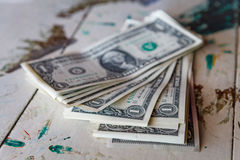 Money - one dollar bills on vintage table. One dollar bills on vintage table royalty free stock photography