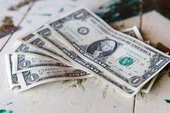 Money - one dollar bills on vintage table. One dollar bills on vintage table royalty free stock images
