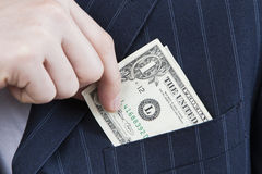 Money from one own's pocket Stock Images