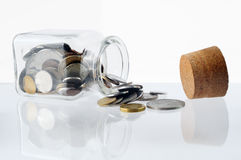 Money in a open glass jar Royalty Free Stock Photography