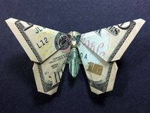 Money Origami Butterfly - Dollar Bill Art. This is a beautifully crafted Money Origami Butterfly made with real ten dollar bill Royalty Free Stock Photos
