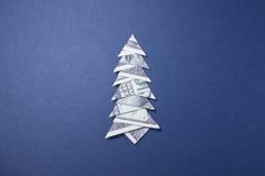 Money Origami Christmas tree. Christmas tree origami made of banknotes dollar. Handmade Stock Photography
