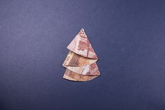 Money Origami Christmas tree. Christmas tree origami made of banknotes rubles. Handmade Royalty Free Stock Photos