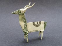 Money Origami Deer - Dollar Bill Art. This is a beautifully crafted Money Origami Deer made with real dollar bill Stock Images
