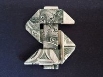 Money Origami Dollar Sign - Dollar Bill Art. This is a beautifully crafted Money Origami Dollar Sign made with real dollar bill Royalty Free Stock Photos