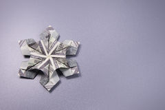 Money Origami snowflake. Snowflake origami made of banknotes dollar Handmade Stock Photography