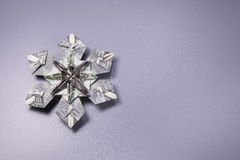 Money Origami snowflake. Snowflake origami made of banknotes dollar Handmade Stock Photos
