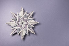Money Origami snowflake. Snowflake origami made of banknotes dollar Handmade Royalty Free Stock Photo