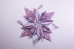 Money Origami snowflake. Snowflake origami made of banknotes euro. Handmade Royalty Free Stock Photos