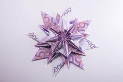 Money Origami snowflake. Snowflake origami made of banknotes euro. Handmade Royalty Free Stock Image