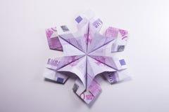 Money Origami snowflake. Snowflake origami made of banknotes euro. Handmade Stock Photo