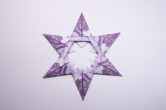 Money Origami snowflake. Snowflake origami made of banknotes euro. Handmade Stock Photography
