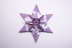 Money Origami snowflake. Snowflake origami made of banknotes euro. Handmade Royalty Free Stock Photo