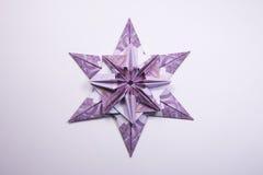Money Origami snowflake. Snowflake origami made of banknotes euro. Handmade Stock Photos