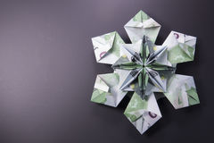 Money Origami snowflake. Snowflake origami made of banknotes euro. Handmade Stock Image