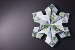 Money Origami snowflake. Snowflake origami made of banknotes euro. Handmade Royalty Free Stock Photography