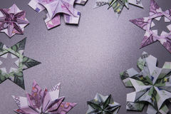 Money Origami snowflake. Snowflake origami made of banknotes euro. Handmade Stock Photography