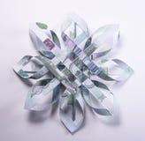 Money Origami snowflake. Snowflake origami made of banknotes rubles. Handmade Royalty Free Stock Photo