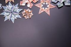 Money Origami snowflake. Snowflake origami made of banknotes rubles. Handmade Stock Photos