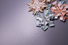 Money Origami snowflake. Snowflake origami made of banknotes rubles. Handmade Stock Photo