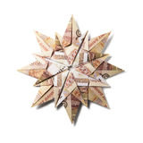Money Origami snowflake. Snowflake origami made of banknotes on a white background. Handmade Stock Photos