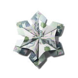 Money Origami snowflake. Snowflake origami made of banknotes on a white background. Handmade Royalty Free Stock Photo