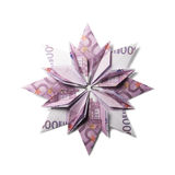 Money Origami snowflake. Snowflake origami made of banknotes on a white background. Handmade Royalty Free Stock Photography