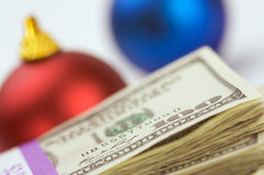 Money and Ornaments. Money and Christmas Ornaments with Narrow Depth of Field Royalty Free Stock Photos
