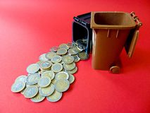 Money out from a Ton. Geld aus der Mülltonne! Money out of a Ton Royalty Free Stock Images
