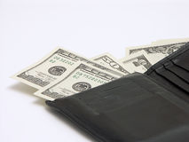 Money out of wallet. Dollar bills and wallet royalty free stock images
