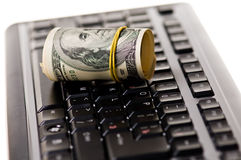 Money over keyboard Stock Photos