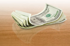Money over a table Royalty Free Stock Photography