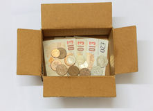 Money in a cardboard box Stock Images